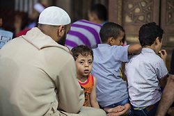 June 4, 2017 - Cairo, Egypt - A child sitting in front of his father during the Taraweeh prayer The tenth day of Ramadan in Cairo, Egypt, on June 5, 2017. (Credit Image: © Fayed El-Geziry/NurPhoto via ZUMA Press)