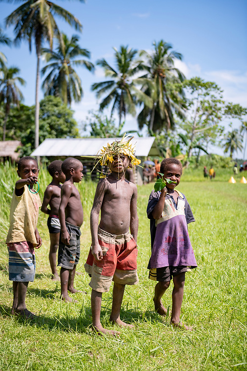 Children at the end of the airstrip in Likan, Papua New Guinea<br /> <br /> (June 20 2019)