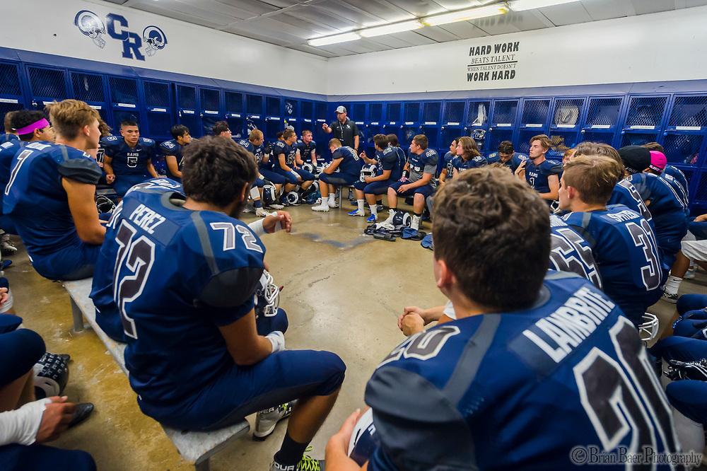 Casa Roble High School Ram head coach Chris Horner, talks to his team inside the locker room before the game as the Casa Roble High School Rams host the Ponderosa High School Bruins, Friday Sep 7, 2018.