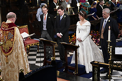 The Duke of York (right) stands next to his daughter Princess Eugenie and her groom Jack Brooksbank and his best man, his brother Thomas, as the Dean of Windsor Revd David Conner, during their wedding ceremony at St George's Chapel in Windsor Castle.