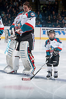 KELOWNA, CANADA - JANUARY 23: The Pepsi Save On Foods Player of the Game lines up with Jackson Whistle #1 of Kelowna Rockets against the Everett Silvertips on January 23, 2015 at Prospera Place in Kelowna, British Columbia, Canada.  (Photo by Marissa Baecker/Shoot the Breeze)  *** Local Caption *** Pepsi Save on Foods Player; Jackson Whistle;