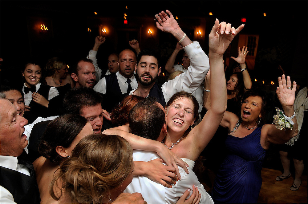 The bride and groom dance with friends and family during their wedding reception held at The Chandelier at Flanders Valley Golf Course in Flanders, New Jersey.