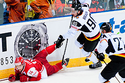 Constantin Braun of Germany trips Kirill Starkov of Denmark during ice-hockey match between Denmark and Germany of Group E in Qualifying Round of IIHF 2011 World Championship Slovakia, on May 7, 2011 in Orange Arena, Bratislava, Slovakia. (Photo by Matic Klansek Velej / Sportida)
