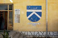26 SEP 2004, KUNDUZ/AFGHANISTAN:<br /> Wappen 1. Deutsches Einsatzkontingent an einer Gebaeudewand, Provincial Reconstruction Team des Deutsche Einsatzkontingents ISAF, PRT ISAF, Lager Kunduz<br /> IMAGE: 20040926-01-108<br /> KEYWORDS: Reise, Bundeswehr, Auslandseinsatz, Schild, sign, Logo