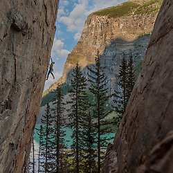 Joshua Janes climbing the classic 5.11c Dew Line at Back of the Lake, Lake Louise, Banff National Park, Alberta, Canada