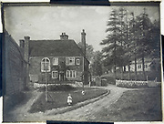 Magic lantern slide of painting girl young girl standing outside large house near a church, rural scene circa 1900, England, UK location unknown