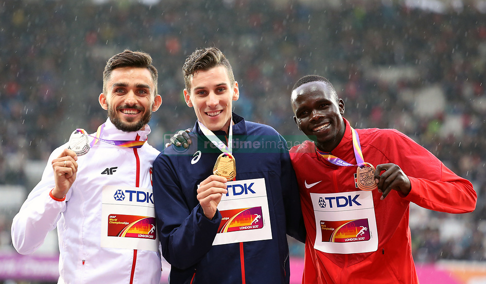France's Pierre-Ambroise Bosse (gold), Poland's Adam Kszczot (silver) and Kenya's Kipyegon Bett (bronze) with their medals for the Men's 800m during day six of the 2017 IAAF World Championships at the London Stadium. PRESS ASSOCIATION Photo. Picture date: Wednesday August 9, 2017. See PA story ATHLETICS World. Photo credit should read: Martin Rickett/PA Wire. RESTRICTIONS: Editorial use only. No transmission of sound or moving images and no video simulation