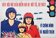 Campaign sign to promote the use of helmets and respect of redlight signals in Hanoi City, Vietnam, Southeast Asia