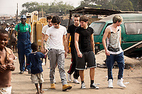 One Direction walking through the Agbogbloshie slum in Accra