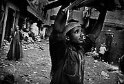 Manchiet Nasr. Men have returned with garbage.