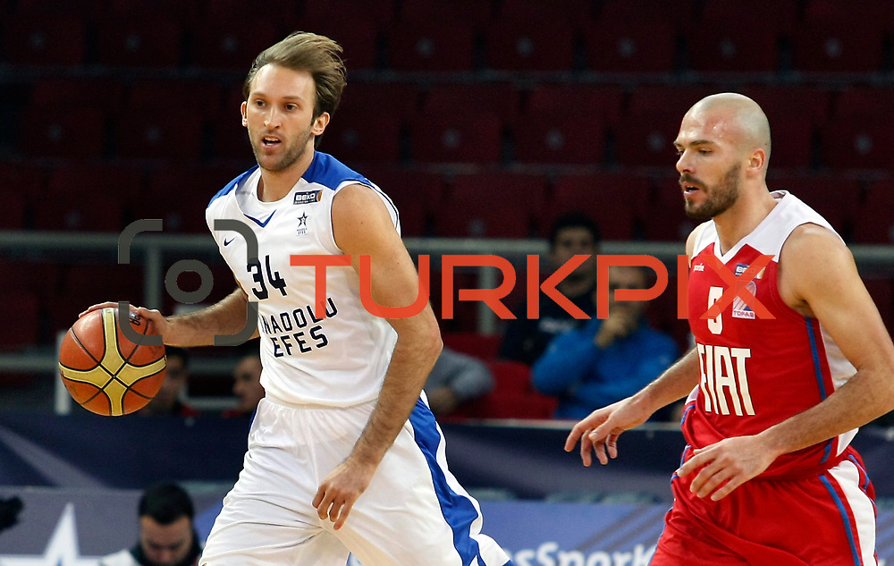 Anadolu Efes's Zoran Planinic (L) and Tofas's Evren Buker (R) during their Turkish Basketball League match Anadolu Efes between Tofas at the Abdi ipekci Arena in Istanbul, Turkey on Tuesday, 24 December, 2013. Photo by TURKPIX