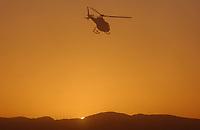Motor<br /> Paris Dakar 2004<br /> Foto: Digitalsport<br /> Norway Only<br /> 07.01.2004<br /> <br /> HELICOPTER SUNSET ILLUSTRATION