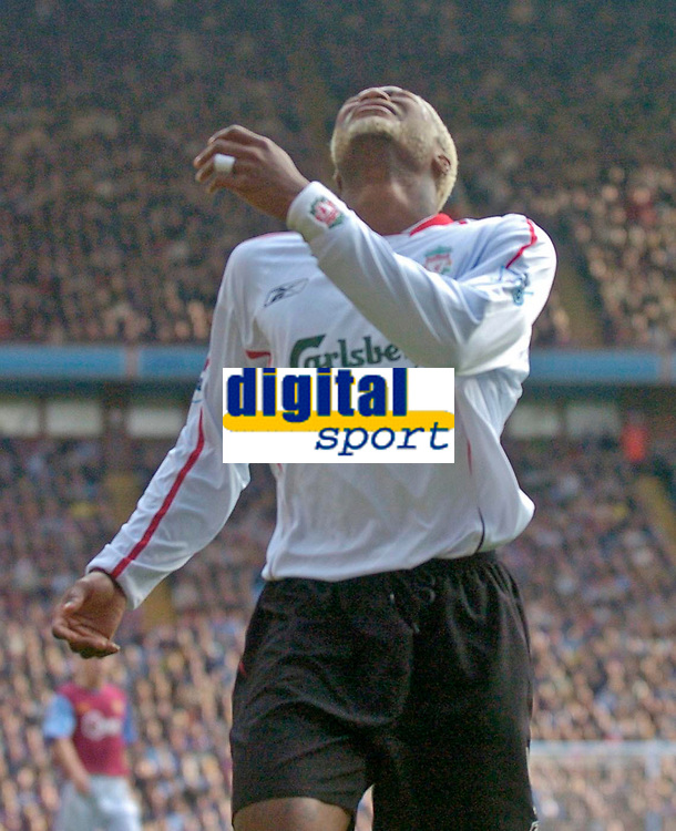 Photo: Glyn Thomas.<br />Aston Villa v Liverpool. The Barclays Premiership. <br />05/11/2005.<br />Liverpool's Djibril Cisse cannot believe he has missed a great chance to score a goal.