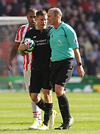 Liverpool's James Milner talks to referee Mike Dean. Premier league match, Stoke City v Liverpool at the Bet365 Stadium in Stoke on Trent, Staffs on Saturday 8th April 2017.<br /> pic by Bradley Collyer, Andrew Orchard sports photography.