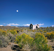 A Daylight Moon Overlooking An Abandoned And Roofless Stone Shack In The Nevada Desert Near Death Valley, USA
