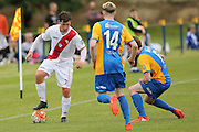 Waitakere United's Stefan Thelen, left, holds the ball from Southern United's Ross Howard, centre, and Danny Ledwith, right, in the Stirling Sports Premiership football match, Peter Johnstone Park, Mosgiel, New Zealand, Saturday, January 21, 2017. © Copyright photo: Adam Binns / www.photosport.nz