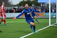 AFC Wimbledon midfielder Scott Wagstaff (7) celebrating after scoring goal to make it 1-0 during the EFL Sky Bet League 1 match between AFC Wimbledon and Gillingham at the Cherry Red Records Stadium, Kingston, England on 23 November 2019.