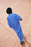 Nomad walk in the Sahara desert, holding his dromedary on a rope.