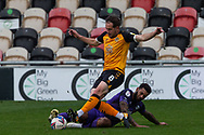 Newport County's Matthew Dolan (8) is tackled by Tranmere Rover's Kaiyne Woolery during the EFL Sky Bet League 2 match between Newport County and Tranmere Rovers at Rodney Parade, Newport, Wales on 17 October 2020.