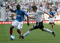Photo: Steve Bond. <br />Derby County v Portsmouth. Barclays Premiership. 11/08/2007. John Utaka (L) attacks defender Andy Griffin (R)
