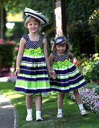Lucille (8) and Beatrice (4) de Kuiper pose for photographers during day four of Royal Ascot at Ascot Racecourse.
