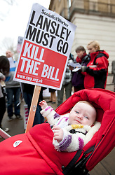 © licensed to London News Pictures. London, UK 17/03/2012. Frankie Crane, an 8 month-old is at the UK Uncut demonstration with her parents against the Government's Health and Social Care Bill currently passing through Parliament, outside Department of Health, London. Photo credit: Tolga Akmen/LNP