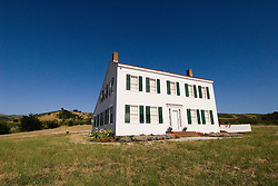 Historic Johnston House, New England saltbox style house, in Half Moon Bay, .San Mateo Coast of California, south of San Francisco.  Photo copyright Lee Foster, 510-549-2202, lee@fostertravel.com, www.fostertravel.com.  Photo 448-30926