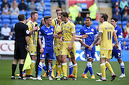 Millwall's Sid Nelson (35) has words with Craig Noone of Cardiff city. Skybet football league championship, Cardiff city v Millwall at the Cardiff city stadium in Cardiff, South Wales on Saturday 18th April 2015<br /> pic by Andrew Orchard, Andrew Orchard sports photography.