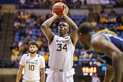 Dec 1, 2019; Morgantown, WV, USA; West Virginia Mountaineers forward Oscar Tshiebwe (34) shoots a foul shot during the second half against the Rhode Island Rams at WVU Coliseum. Mandatory Credit: Ben Queen-USA TODAY Sports