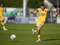 Sutton United's Rob Milsom scores his sides first goal of the game during the Sky Bet League Two match at Borough Sports Ground, Sutton. Picture date: Saturday October 9, 2021.