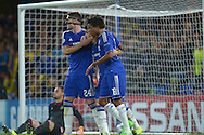 Oscar of Chelsea © celebrates after he scores his sides second goal from a penalty spot to make 2-0 with teammates Gary Cahill of Chelsea and Loic Remy of Chelsea. UEFA Champions League group G match, Chelsea v Maccabi Tel Aviv at Stamford Bridge in London on Wednesday 16th September 2015.<br /> pic by John Patrick Fletcher, Andrew Orchard sports photography.