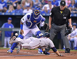 September 8, 2017 - Kansas City, MO, USA - The Minnesota Twins' Brian Dozier tags up and dives in to score ahead of the throw to Kansas City Royals catcher Salvador Perez on a sacrifice fly by Eddie Rosario in the first inning at Kauffman Stadium in Kansas City, Mo., on Friday, Sept. 8, 2017. (Credit Image: © John Sleezer/TNS via ZUMA Wire)