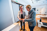 Furniture conservation professor Charlotta Ekholm collaborating with Susanna Salifou Nygren who teaches color and form at the school. They are prepping for a teacher-curated exhibition focusing on surface materials.