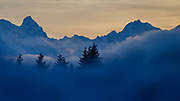 Sunset over the alps while clouds fill the valley around the Swiss city Davos during the World Economic Forum