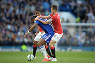 Adnan Januzaj of Manchester United grabs onto  Didier Drogba of Chelsea. Barclays Premier league match, Chelsea v Manchester Utd at Stamford Bridge Stadium in London on Saturday 18th April 2015.<br /> pic by John Patrick Fletcher, Andrew Orchard sports photography.