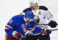 Ishockey 140410 Buffalos Henrik Tallinder (t h) tacklar New Yorks Rick Nash (t v) under ishockeymatchen i NHL mellan New York Rangers och Buffalo Sabres den 10 april 2014 i New York.<br /> <br /> Norway only