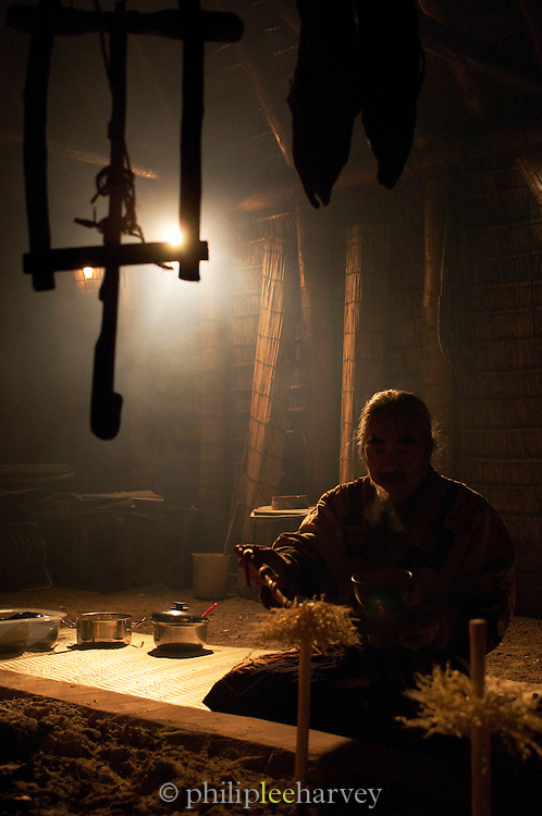 Ainu man in a traditional hut. The Ainu people are indigenous to Japan and Russia. Hokkaid?, Japan