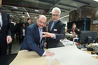 22 FEB 2017, KOENIGS WUSTERHAUSEN/GERMANY:<br /> Dietmar Woidke, SPD, Ministerpraesident Brandenburg, und Martin Schulz, SPD, Kanzlerkandidat, besuchen die Firma Schelchen GmbH, pedag International<br /> IMAGE: 20170222-01
