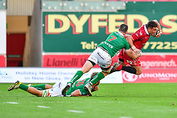 Kieron Fonotia of Scarlets is tackled by Marco Barbini and Braam Steyn of Benetton Treviso<br /> <br /> Photographer Craig Thomas/Replay Images<br /> <br /> Guinness PRO14 Round 3 - Scarlets v Benetton Treviso - Saturday 15th September 2018 - Parc Y Scarlets - Llanelli<br /> <br /> World Copyright © Replay Images . All rights reserved. info@replayimages.co.uk - http://replayimages.co.uk