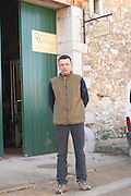 Vincent Guizard of Dom Saint Sylvestre in front of Domaine de Montcalmes in Puechabon. Terrasses de Larzac. Languedoc. A door. Owner winemaker. France. Europe.