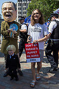 On the day that the Conservative Party elects its leader and the country's Prime Minister, Boris Johnson, a Boris puppet and Nigel Farage puppetmaster appears outside the QE2 Centre to learn the result, on 23rd July 2019, in Westminster, London, England.