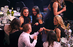 Liverpool Ladies' Caroline Weir (back left) and Katie Zelem (back right) speak with Manchester City Women's manager Nick Cushing (centre) and Keira Walsh (right) during the Professional Footballers' Association Awards 2017 at the Grosvenor House Hotel, London