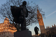 The silhouetted statues of David Lloyd-George and Winston Churchill, on 17th January 2017, in Parliament Square, Westminster, London England. David Lloyd George 1st Earl Lloyd-George of Dwyfor, OM, PC was a British Liberal politician and statesman.