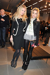 Left to right, MARISSA MONTGOMERY and CHELSEA LEYLAND at an invitation-only acoustic performance by Rita Ora hosted by Calvin Klein Jeans at their Regent Street Store, London on 18th February 2013.