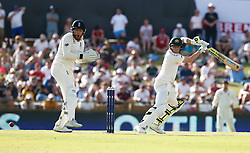 Australia's Steve Smith plays a shot as Jonny Bairstow looks on during day two of the Ashes Test match at the WACA Ground, Perth.