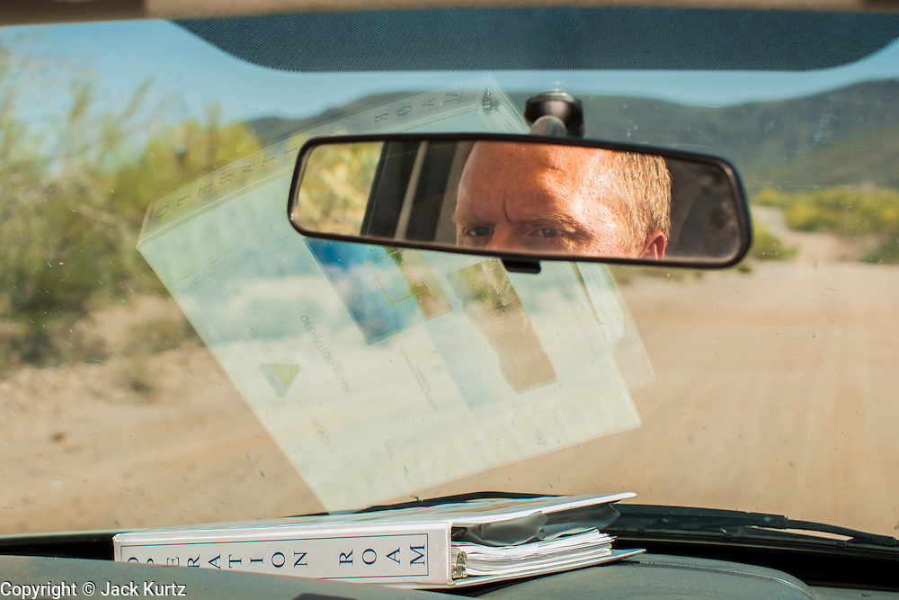 """03 MAY 2012 - VEKOL VALLEY, RURAL PINAL COUNTY, AZ:   Jon Young (CQ Jon), the BLM  Chief Ranger for Arizona, patrols on Bureau of Land Management land south of Interstate 8 and west of Casa Grande in rural Pinal County. The area has been a hotbed of illegal immigrant and drug smuggling for years. The BLM has undertaken a series of """"surges"""" in the area, increasing their law enforcement patrols and partnering with Border Patrol and Pinal County Sheriff's Department officers to reduce criminal activity in the area.       PHOTO BY JACK KURTZ"""