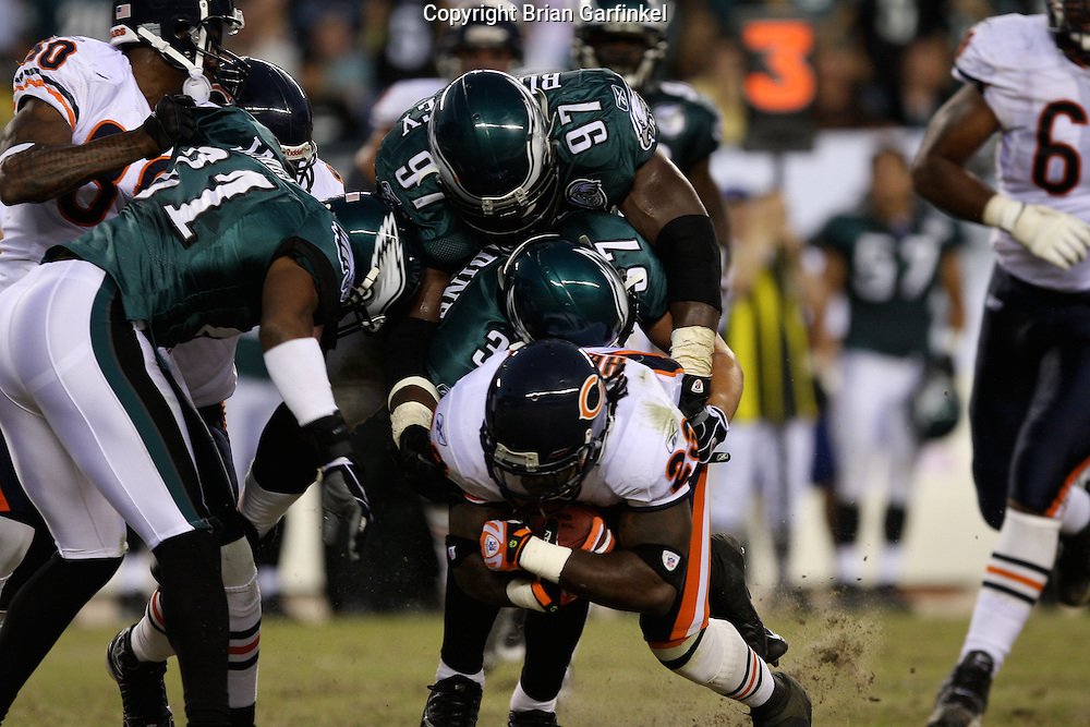 PHILADELPHIA - OCTOBER 21: Philadelphia Eagle's defense makes a tackle during the game against the Chicago Bears on October 21, 2007 at Lincoln Financial Field in Philadelphia, Pennsylvania. The Bears won 19-16.