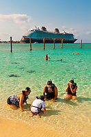 Passengers learning to snorkel, Castaway Cay (Disney's private island), Disney Dream cruise ship docked in background , The Bahamas
