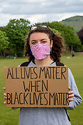 About 500 residents of Folkestone gathered at Radnor Park for a socially distanced show of solidarity in memory of George Floyd, the man recently murdered by Police in Minneapolis, United States on Sunday the 7th of June 2020 in Folkestone, United Kingdom. Home made banners with the slogans Black Lives Matter, Be Anti Racist, All Equal, End Racism and Always Challenge Racism could be seen.