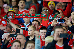 CARDIFF, WALES - Monday, October 9, 2017: A Wales supporter holds up a Wales scarf as he sings the national anthem during the 2018 FIFA World Cup Qualifying Group D match between Wales and Republic of Ireland at the Cardiff City Stadium. (Pic by Paul Greenwood/Propaganda)